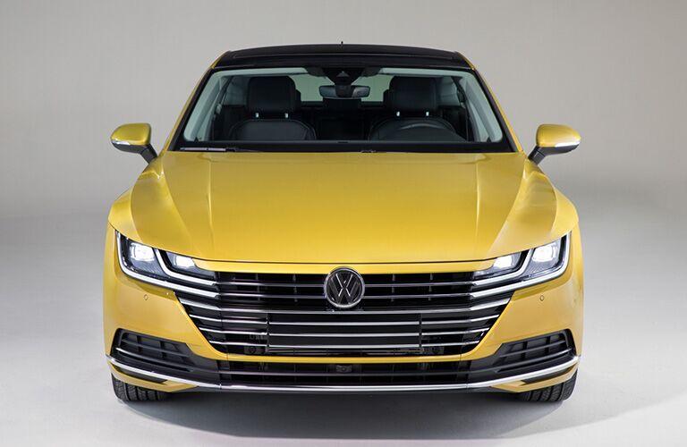 Head-on view of a yellow 2019 Volkswagen Arteon.