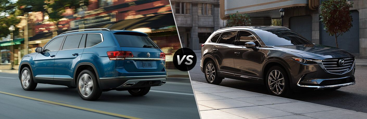 """Blue 2019 Volkswagen Atlas and black 2019 Mazda CX-9, separated by a diagonal line and a """"VS."""" logo."""