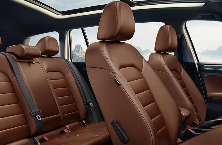 Interior front and rear seats of a 2019 Volkswagen Golf Alltrack, colored brown to mirror the colors of the natural world.