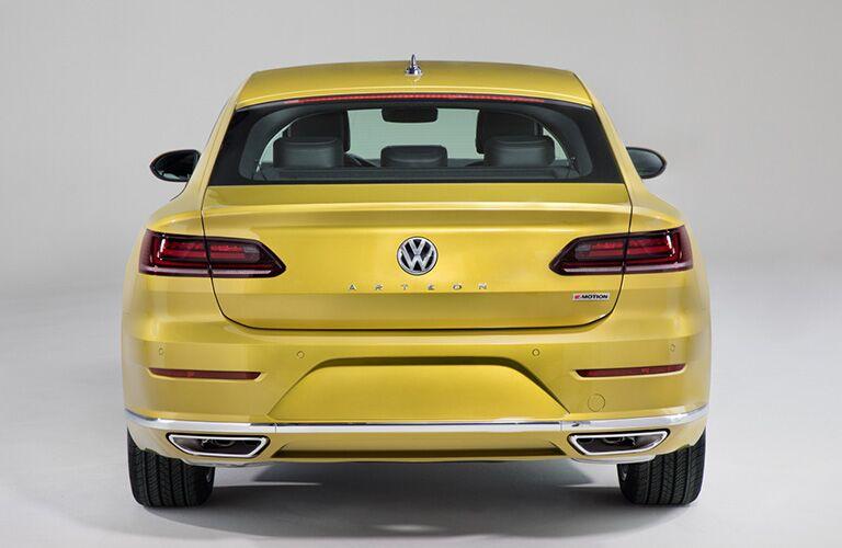 Rear view of a yellow 2019 Volkswagen Arteon.
