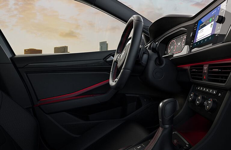 Side view of driver's seat and area inside a 2019 Volkswagen Jetta GLI.
