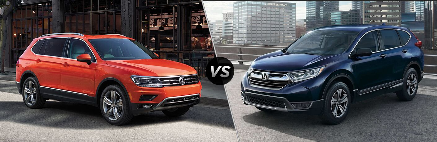"Habanero Orange 2019 Volkswagen Tiguan on a city street, and a 2019 Honda CR-V. Both vehicles are separated by a diagonal line and ""VS"" logo."