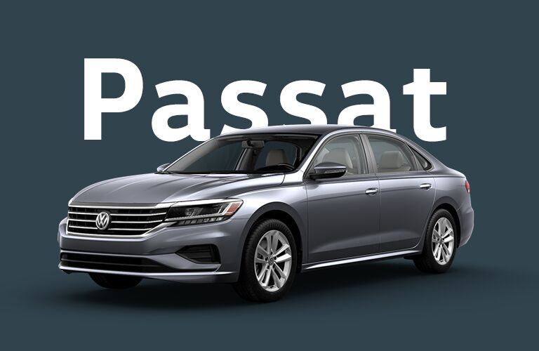 "Blackish Volkswagen Passat that sits in front of a black background and gigantic white text that reads, ""Passat."""