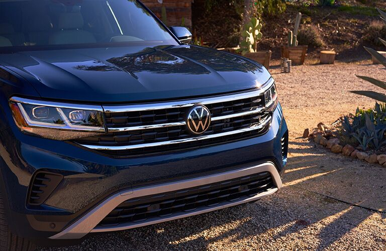 2021 VW Atlas blue exterior close up of front end at beach
