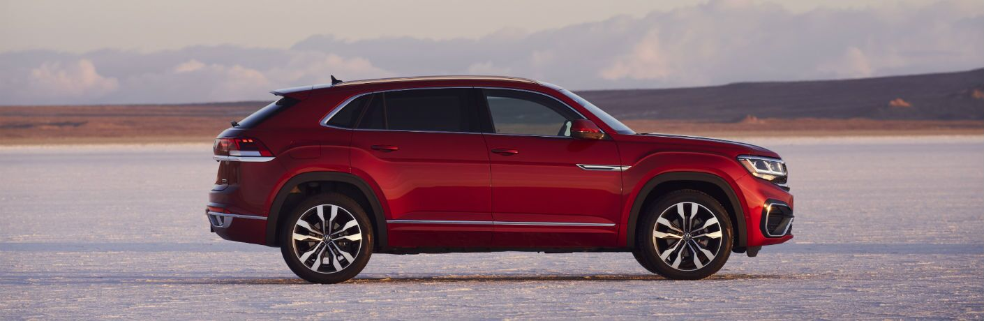 A right profile photo of the 2021 Volkswagen Atlas Cross Sport parked in the desert.