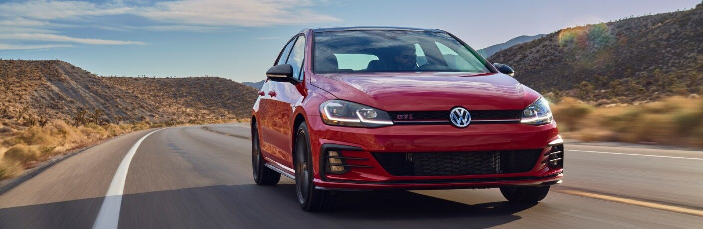 A head-on look at the 2021 Volkswagen Golf GTI on the road.