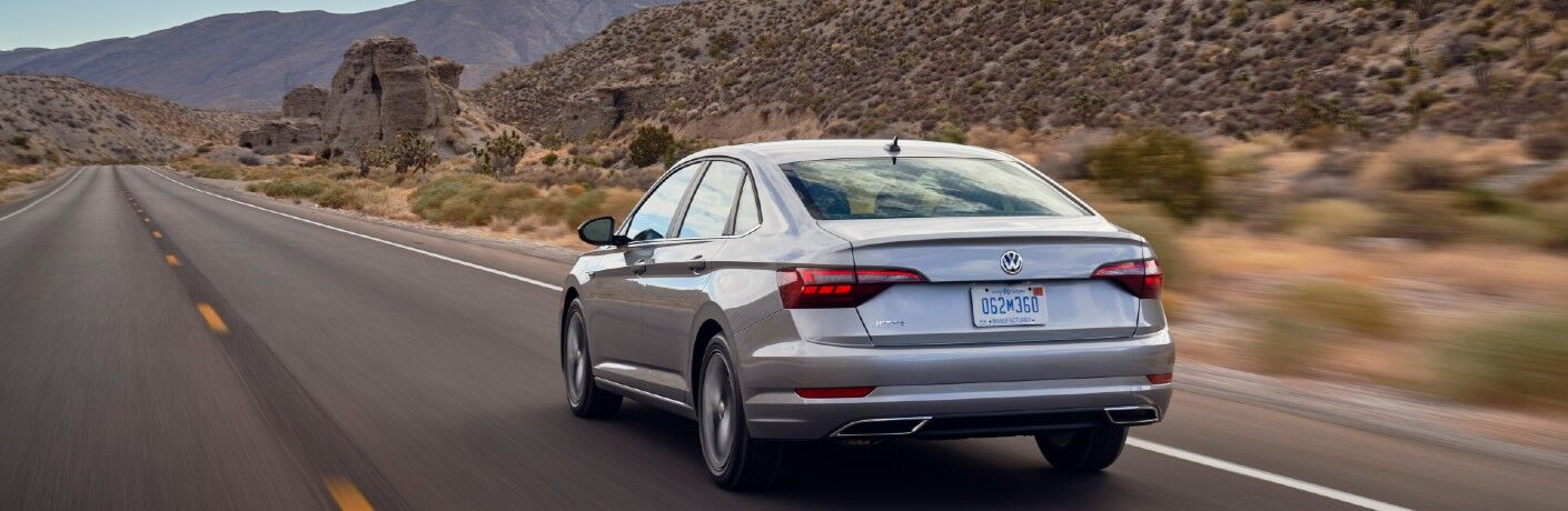 A rear photo of the 2021 Volkswagen Jetta on the road.
