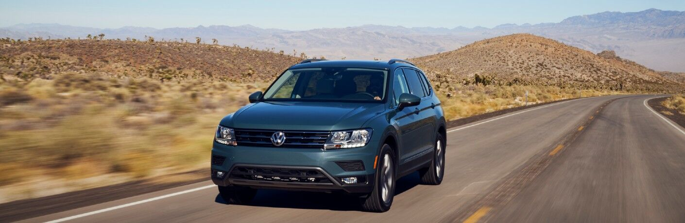 A head-on photo of the 2021 Volkswagen Tiguan in motion on the road.