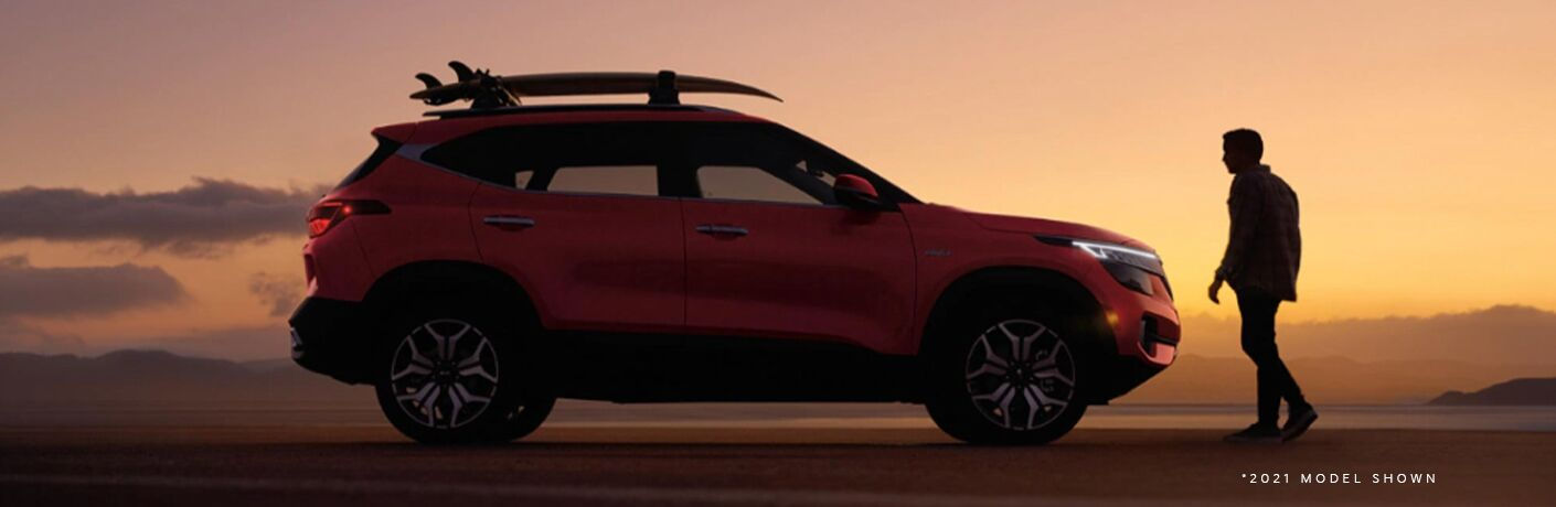 The 2022 Kia Seltos with a man standing near it
