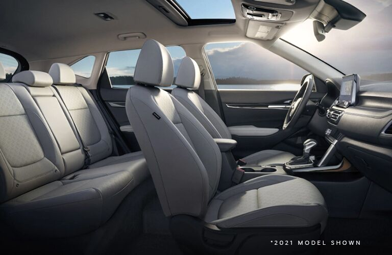 View of the interior seats and front console of the Kia Seltos
