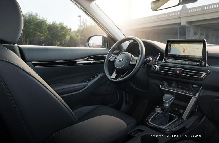 View of the steering wheel and front console of the Kia Seltos
