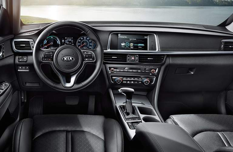 steering wheel and touchscreen in the 2018 Kia Optima Hybrid