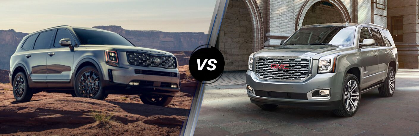 Grey 2020 Kia Telluride on left vs silver 2020 GMC Yukon on right