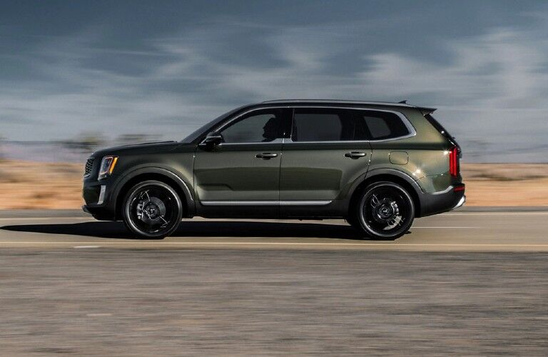 Driver angle of a grey 2020 Kia Telluride driving on a road