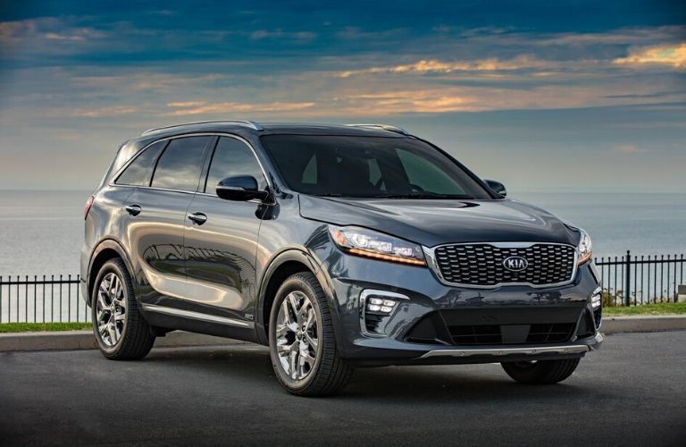 2020 Kia Sorento parked in front of ocean from exterior front passenger side