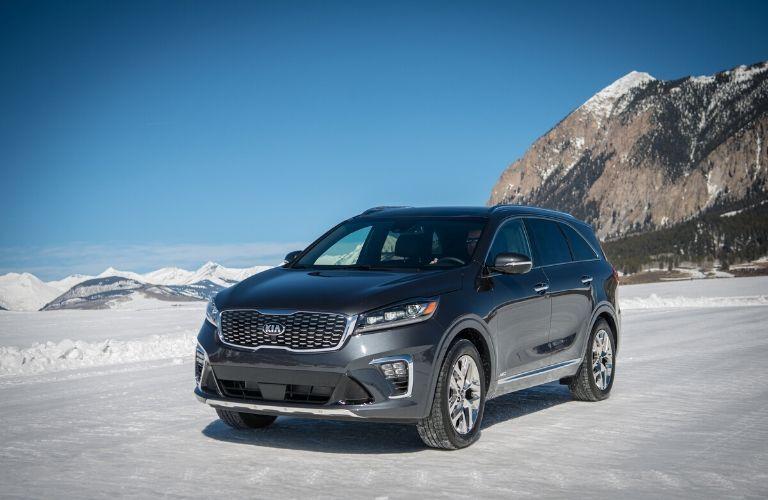 2020 Kia Sorento parked in snow in front of mountain