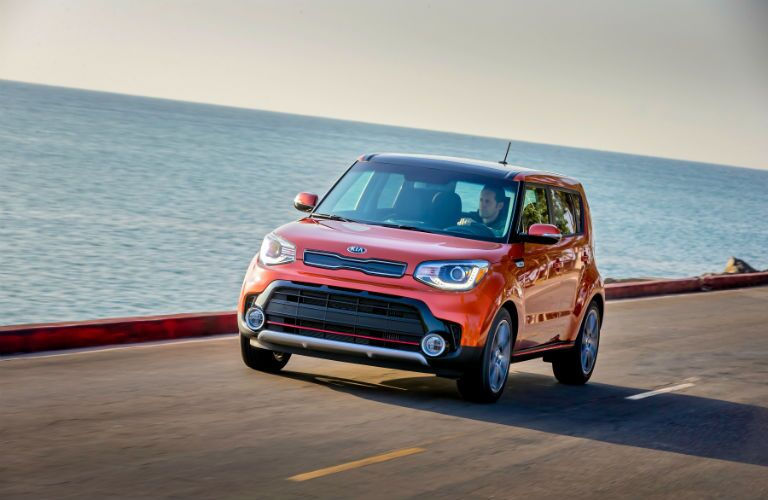 A Left Front Quarter Photo Of The 2019 Kia Soul Driving By The Ocean.