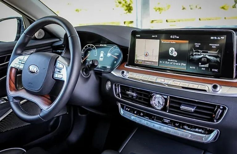 View of the steering wheel and front console of the 2021 Kia K900