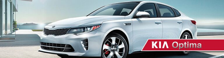 white 2019 Kia Optima with banner