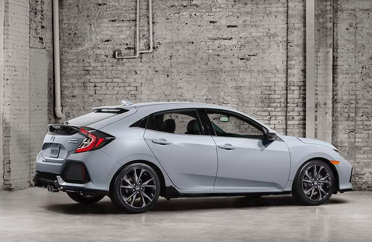 Side exterior view of white 2017 Honda Civic Hatchback