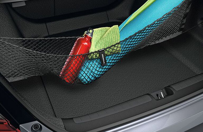 Trunk space of the 2018 Honda Accord Sedan with the available cargo net filled with cargo