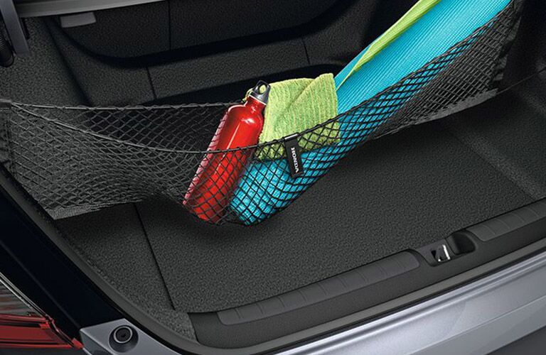 Empty trunk space of the 2018 Honda Accord with available cargo net with yoga equipment in it