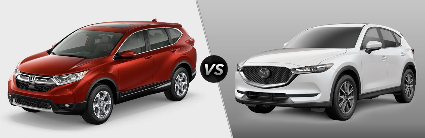 "Drive side exterior view of a red 2018 Honda CR-V on the left ""vs"" driver side exterior view of a white 2018 Mazda CX-5 on the right"