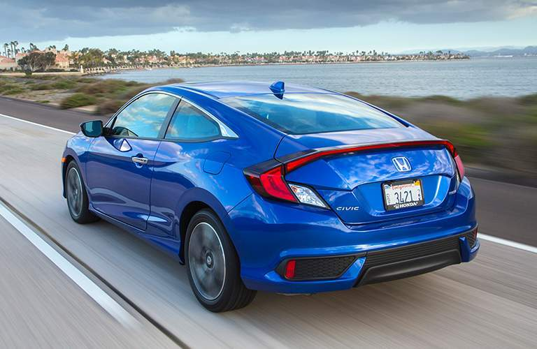 2018 Honda Civic Coupe blue back view on road