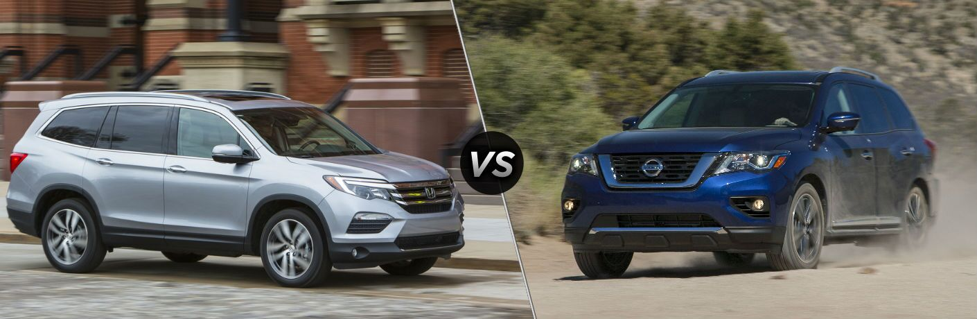 "Passenger side exterior view of a gray 2018 Honda Pilot on the left ""vs"" front exterior view of a blue 2018 Nissan Pathfinder on the right"