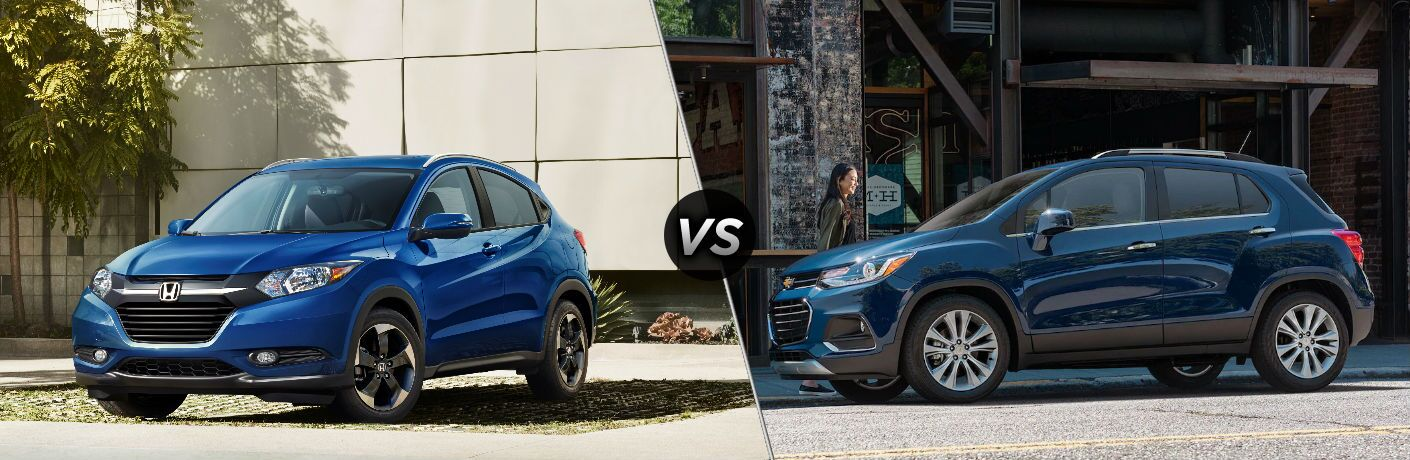 """Driver side exterior view of a blue 2018 Honda HR-V on the left """"vs"""" a driver side exterior view of a blue 2018 Chevy Trax on the right"""