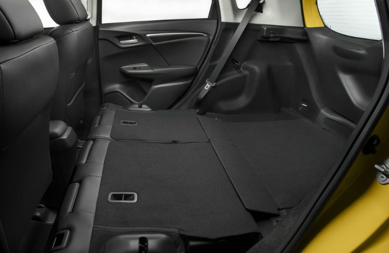 Side view of the rear seats folded flat for storage in the 2018 Honda Fit