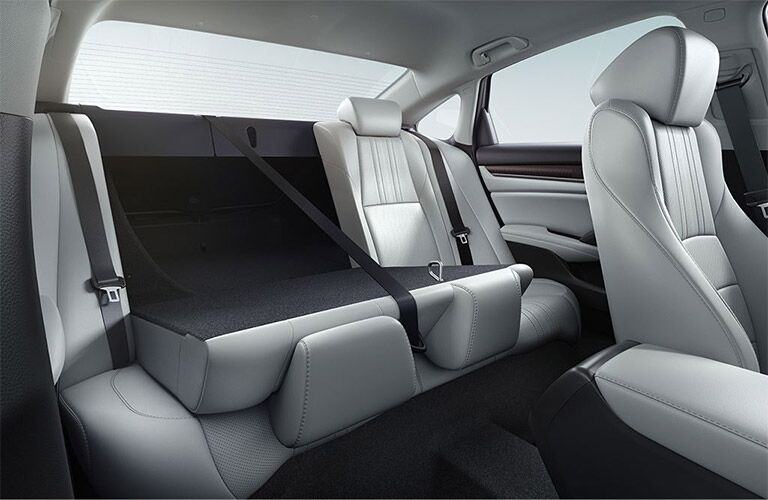 Looking into the rear seat of the 2019 Honda Accord with the the seatback split-folded