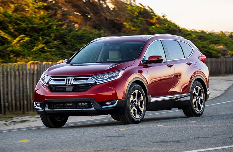 Front driver side exterior view of a red 2019 Honda CR-V