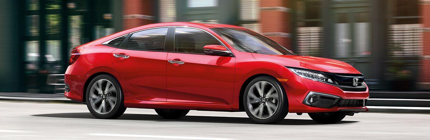 Passenger side exterior view of a red 2019 Honda Civic Sedan