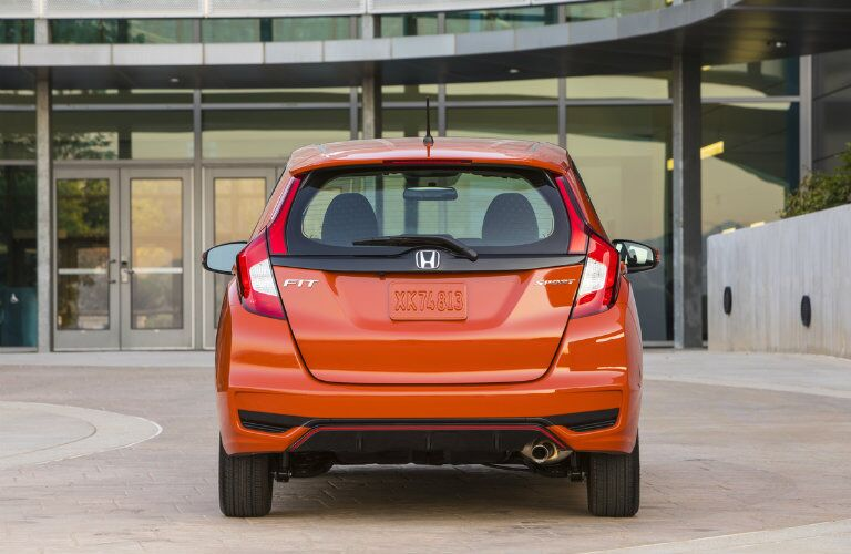 Rear exterior view of an orange 2019 Honda Fit