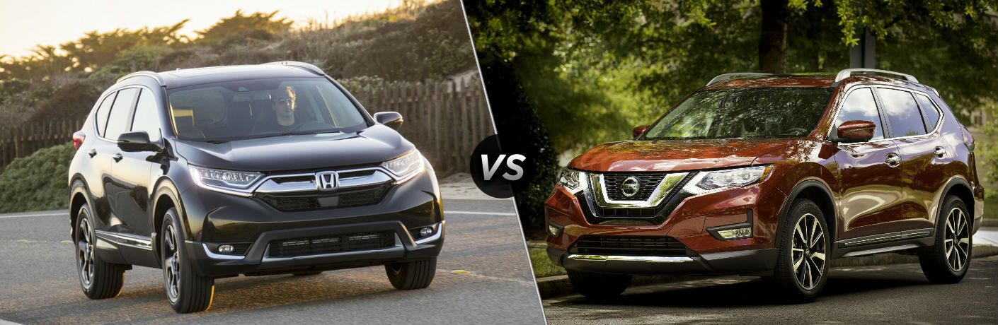 "Front exterior view of a black 2019 Honda CR-V on the left ""vs"" front driver side exterior view of a red 2019 Nissan Rogue on the right"