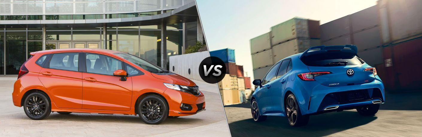 "Passenger side exterior view of an orange 2019 Honda Fit on the left ""vs"" rear driver side exterior view of a blue 2019 Toyota Corolla Hatchback on the right"