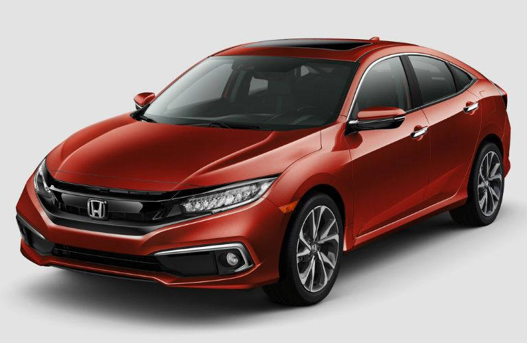 Front driver side exterior view of a red 2019 Honda Civic Sedan