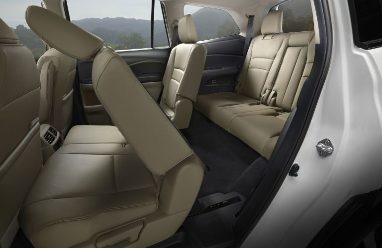 Side view of the 2019 Honda Pilot's second-row seat folded forward for easy access to the third row of seating
