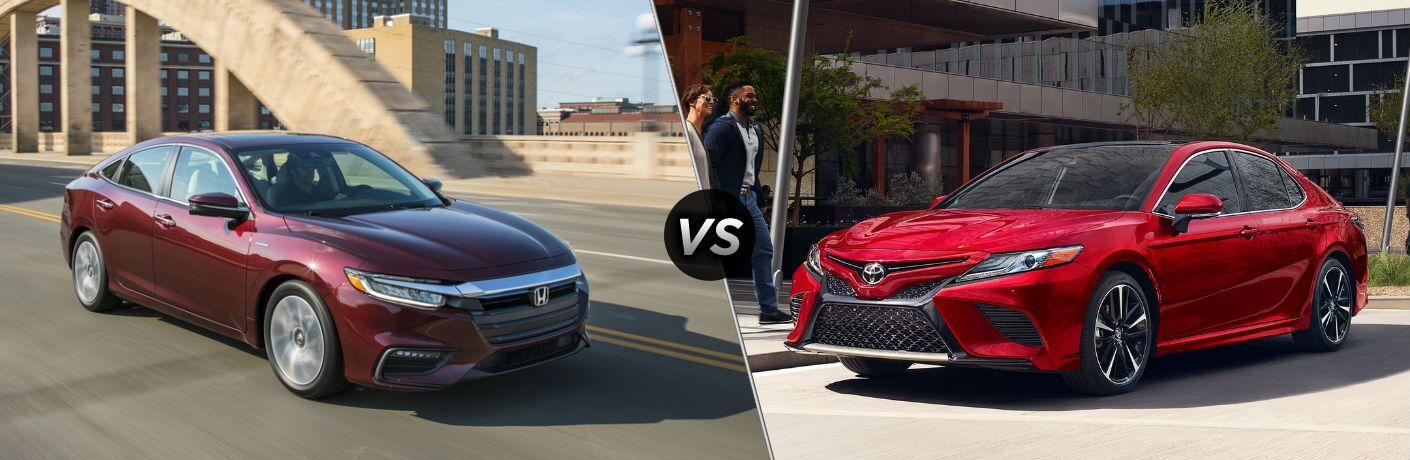 "Passenger side exterior view of a red 2019 Honda Insight on the left ""vs"" driver side exterior view of a red 2019 Toyota Camry Hybrid on the right"