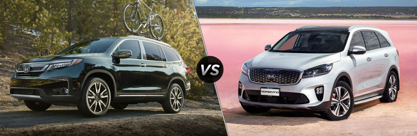 "Driver side exterior view of a black 2019 Honda Pilot on the left ""vs"" driver side exterior view of a gray 2019 Kia Sorento on the right"