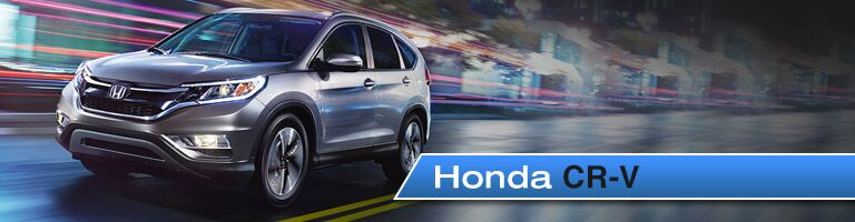 2017 Honda CR V Driving With A Blurred City Background, The Vehicleu0027s Make  And