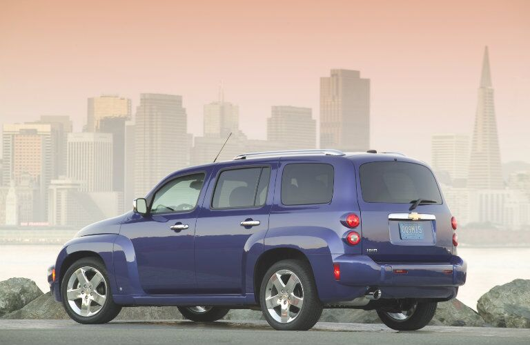 2009 Chevrolet HHR blue exterior shot parked outside at sundown with cityscape background