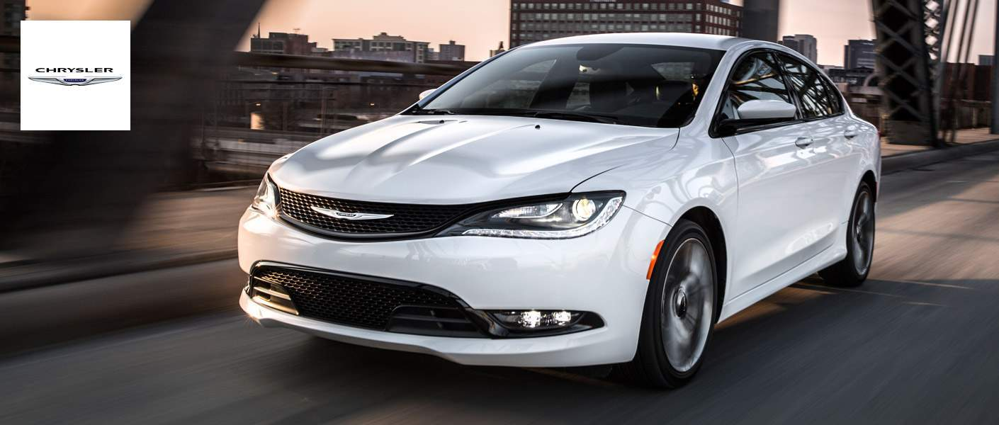Used Chrysler 200 driving down a road