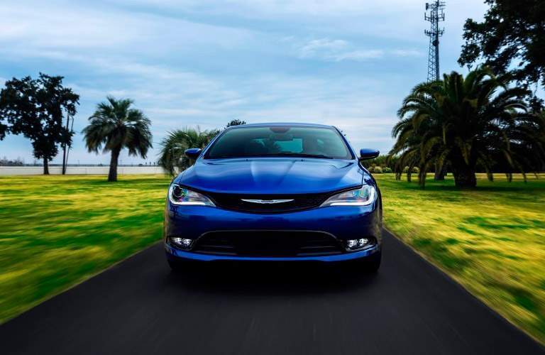 Blue used Chrysler 200 driving