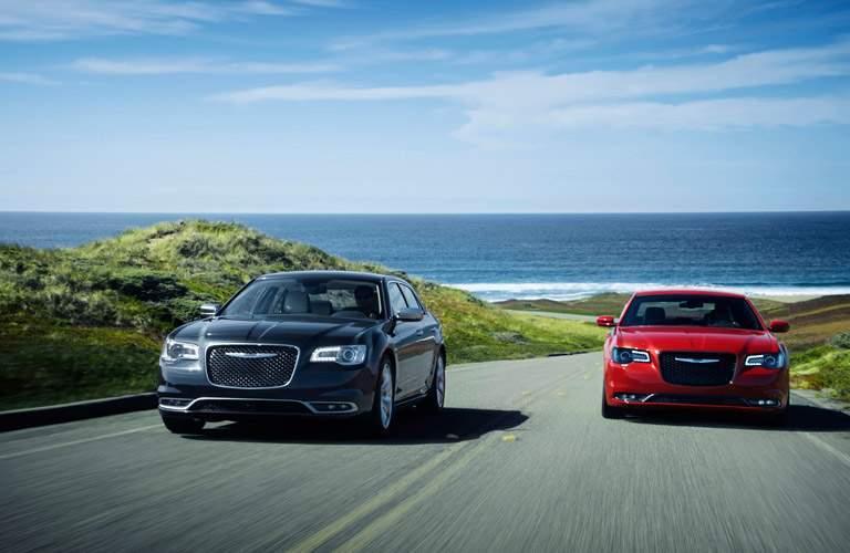 Chrysler 300 sedans racing on curvy road