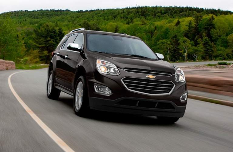 Black 2016 Chevrolet Equinox driving near mountains