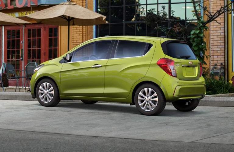 Green 2016 Chevrolet Spark parked on city street