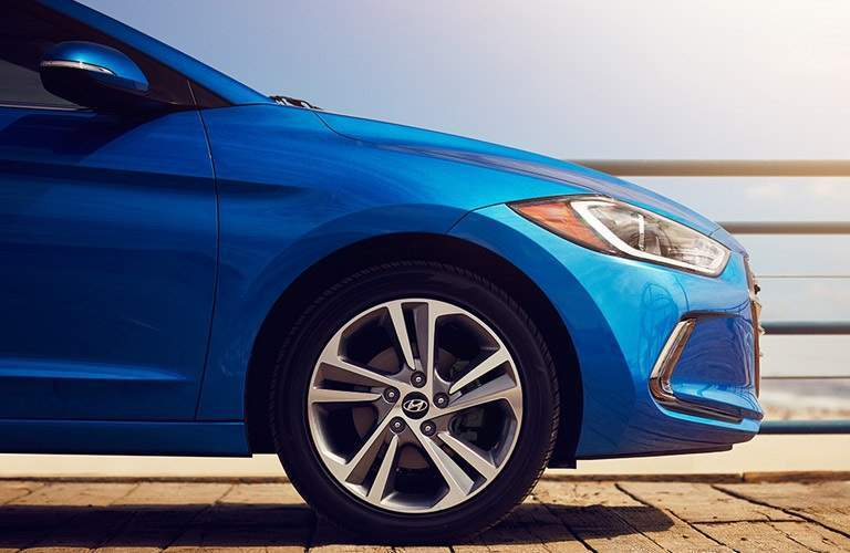 front right tire of a blue 2017 Hyundai Elantra
