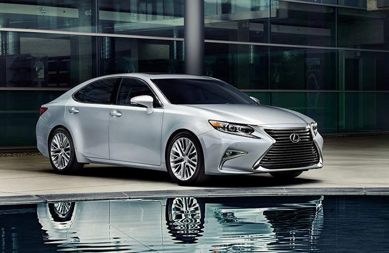 while 2016 Lexus ES with a water reflection